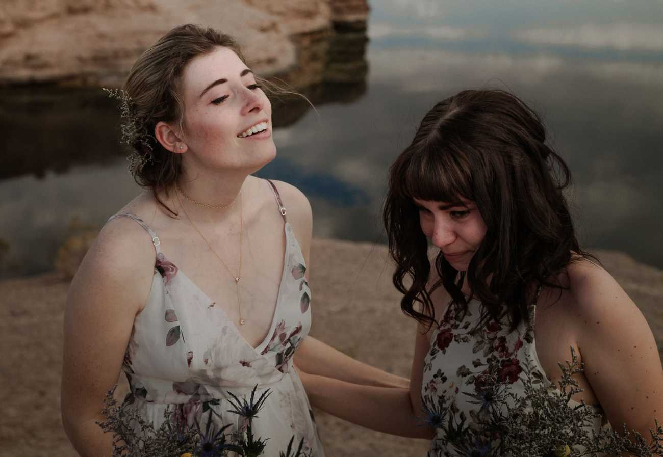 Maid of Honor cries looking at bride