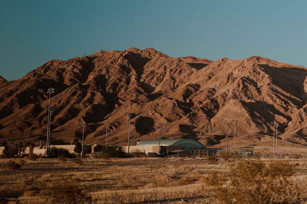 Moody Las Vegas Groom Portraits in the desert