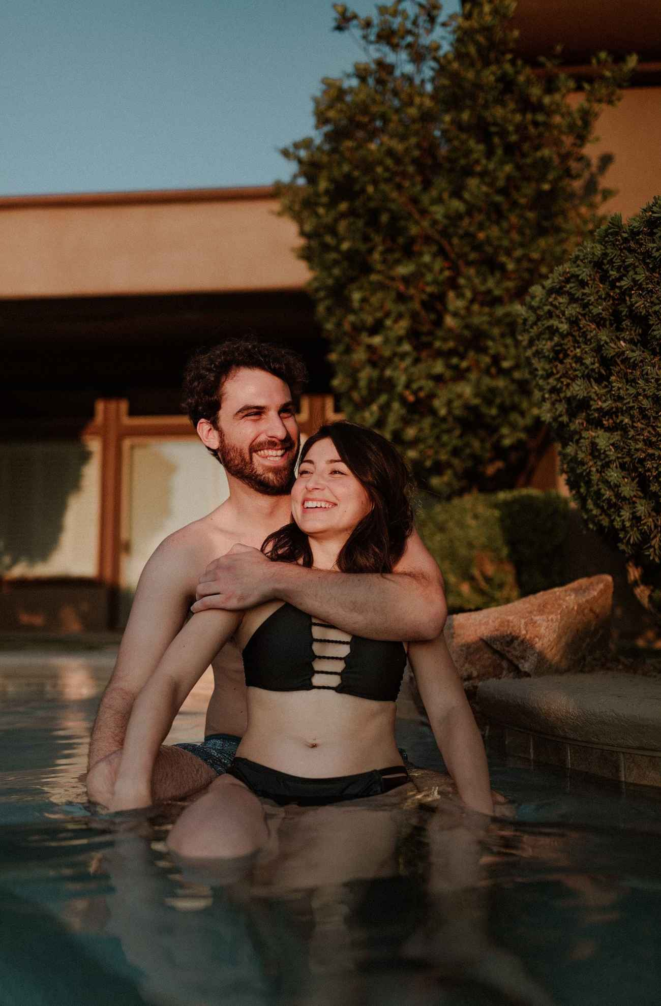 Cute engagement photos in pool by Las Vegas elopement photographer