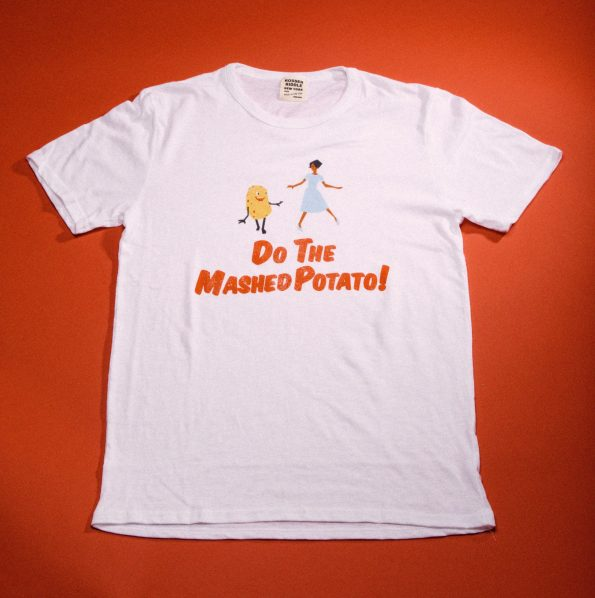 "Father's Day Gift. This t-shirt has a picture of a potatota and a women dancing and the phrase ""Do The Mashed Potato""."