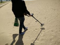 Metal Detector on a beach looking for treasure