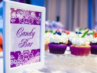 Wedding reception candy bar uplighting and pin spot light white