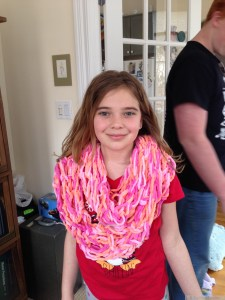Miss K with her arm-knitted scarf.