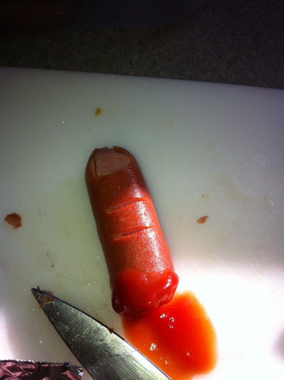 I have a picture of B's finger, but it's too awful to show.  This is just a hotdog made to look like a finger.