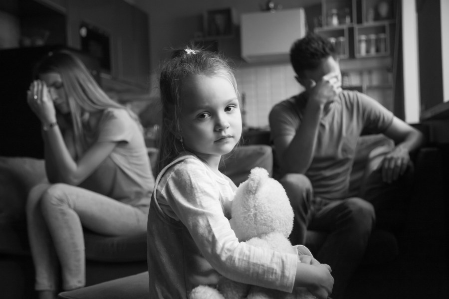 Frustrated girl tired of parents fights, child and divorce concept