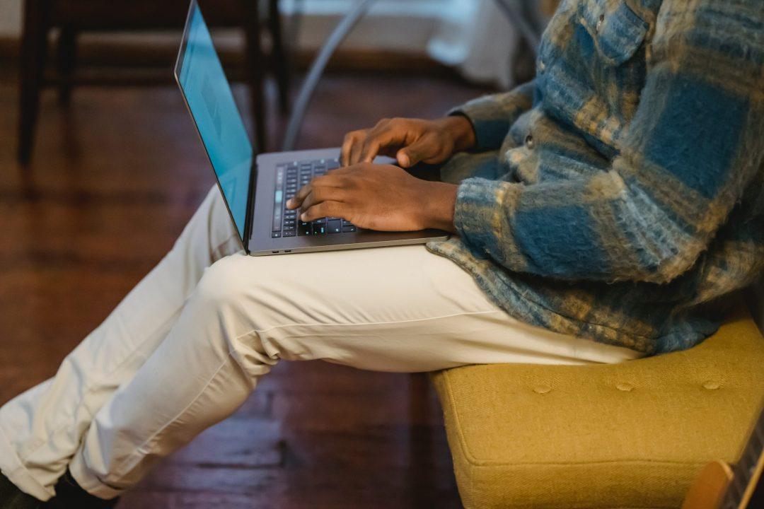 Man sitting typing on laptop
