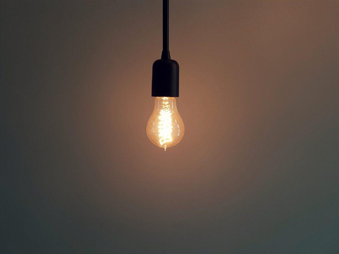 Single light bulb in dim room