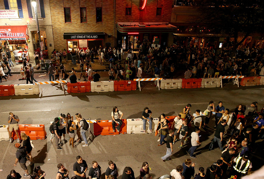AUSTIN, TX - MARCH 15:  Festival goers attend the SXSW Music Opening Party during the 2016 SXSW Music, Film + Interactive Festival at Maggie Mae's on March 15, 2016 in Austin, Texas.