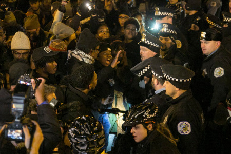 A skirmish broke out between protesters and Chicago Police near Columbus and Balbo on Tuesday, Nov. 24, 2015. The protesters marched against police-involved shootings in the wake of the city's release of a video showing the fatal shooting of 17-year-old Laquan McDonald at the hands of Officer Jason Van Dyke. |