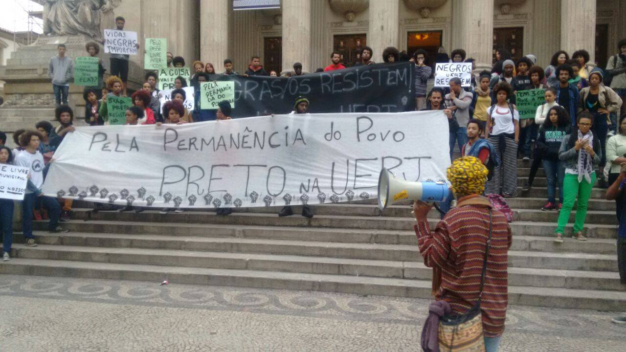 "Black students from colleges across Rio de Janeiro protest ""For the Permanence of Black People at UERJ"" when scholarship funding was threatened at the University of the State of Rio de Janeiro (UERJ) in July 2016. (Photo from Ocupação Preta UFF)"