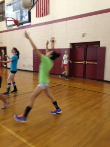 Emily Zhu '16 practices her serve at volleyball practice
