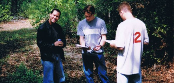 Blake Barham Naleid goes over the scene with actors Marcus Lomas and Taylor Hayden.