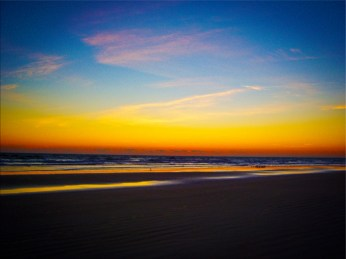 New Art Titled: Beach and Seascape at Dawns Early Light Southeast. This digital photo art edit is my artist version of this photograph. Taken just before sunrise on Daytona Beach, of the beach and Atlantic Ocean facing southeast