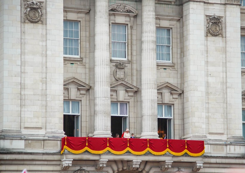 The Queen emerges on the balcony for the flypast.