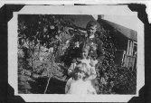 """1919 1919. My great aunt Margaret is the little toddler, in front of my Great Aunt Chrissie and my grandfather at the back. This was photographed in the back garden of """"Enterkin"""" a sandstone house which still stands in Broompark Road next to the park"""