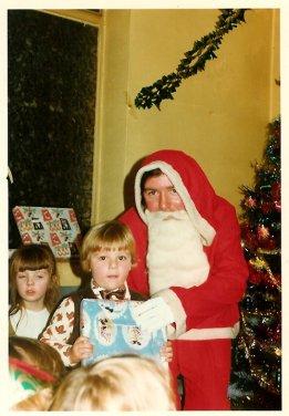 1975 Old Parish Church Hall Santa. Paul Veverka is wee boy