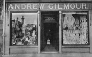 1910s Child stands in the doorway of Gilmours Drapers. Shared by RDS