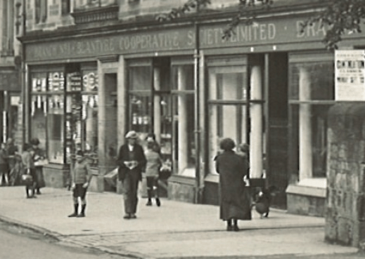 1927 Shopping outside the co-op main street