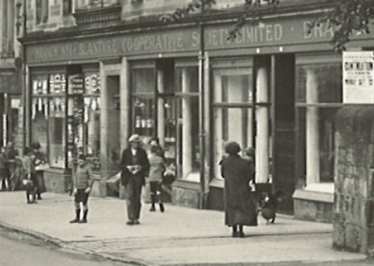 1927 Shopping outside the co-op main street