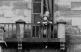 1910 Nanny and Child on the Balcony of Calderwood Castle