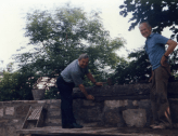Rev Price assists rebuild Kirk wall 1989