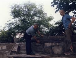 Rev Price assists rebuild Kirk wall 1989