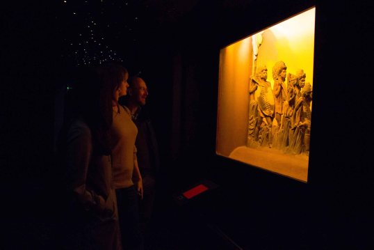 Megan Ward, Kate Simpson, and Adrian Wisnicki view the 'COURAGE'