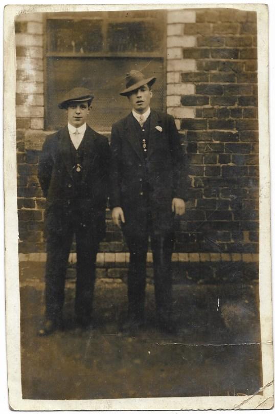 1920s men at brick building