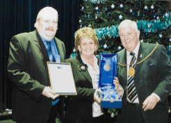 2005 Cllr Bert Thomson presents Cath McINally