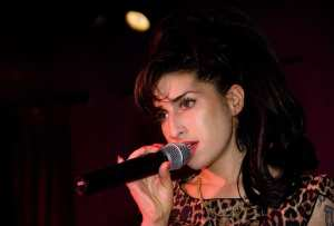 Amy Winehouse performs in London last year (WireImage)