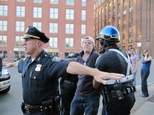 A protester is arrested during the bridge rally (Blast Staff photo/John Stephen Dwyer)