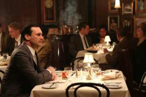 Don Draper (Jon Hamm) sits alone in a restaurant waiting for his mistress, Sylvia (Linda Cardellini) to return.