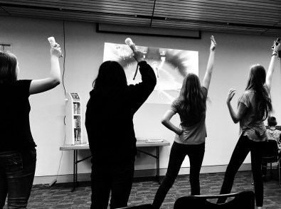 4/22: giggling at the teens playing Just Dance
