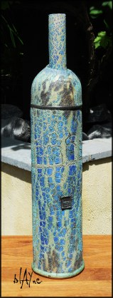 Textured clay bottle.