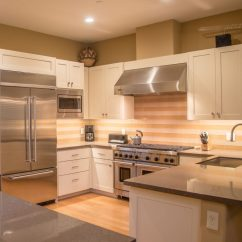 Remodeled Kitchen Cheap Used Appliances Remodeling Renovations Building Pros Danville Ca With Granite Counter Tops And An Orange White Backsplash
