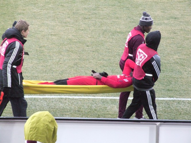 Donovan Ricketts being carried off after his red card penalty and injury