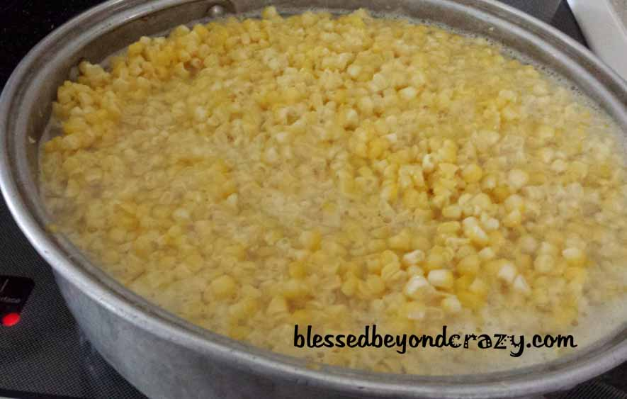 Blanching fresh sweet corn.