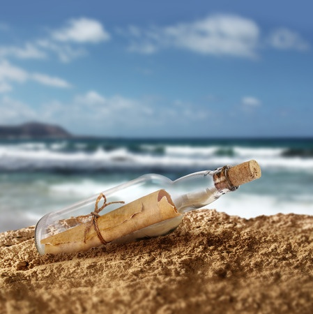 31060251 - message in the bottle on island seashore beach sand