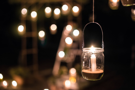 for a truly mystical flair hang candlelit mason jars at various levels on tree branches or on sound structures as your guest arrive they will feel like - Halloween Lighting Ideas