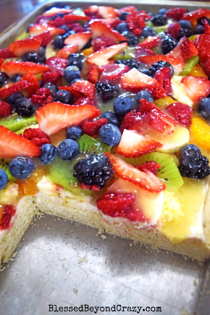 Cut view of The Ultimate Loaded Fruit Pizza, sugar cookies