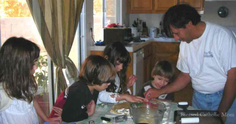 Spend time cooking side by side with our children. Cooking with children can make meal preparation a little longer, but the little extra time is worth the effort when we experience the wonderful results. Image of a father cooking with his children.
