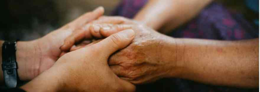 Start a Simple Family Evening Prayer Time. Image of two sets of hands holding each other in prayer. Image credit; lightstock photos