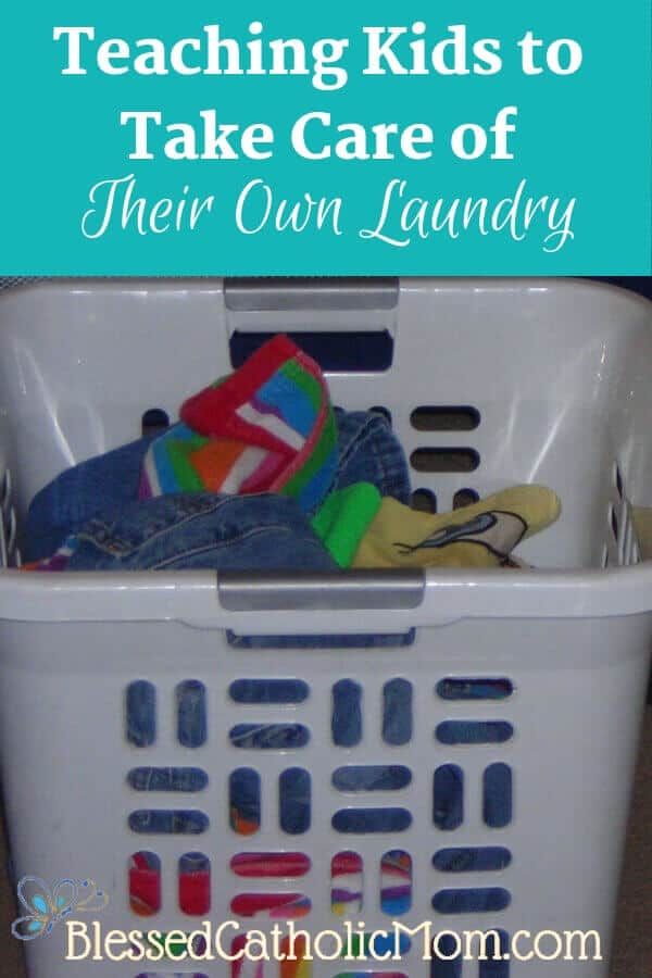 Here is a simple solution to our family's laundry dilemma: kids can do their own laundry. When we work as a family, we share the work load. Image of a white basket full of laundry. Title of article and Blessed Catholic Mom logo on image.