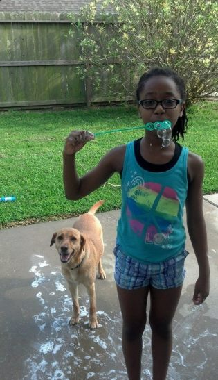 enjoying bubbles with the dog