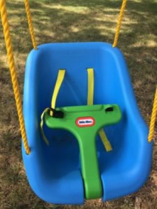 Little Tikes Swing is easy to get baby into and out of. It is also easy to set up in a tree or in a swing set.