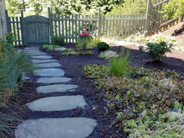 flagstones in plant bed
