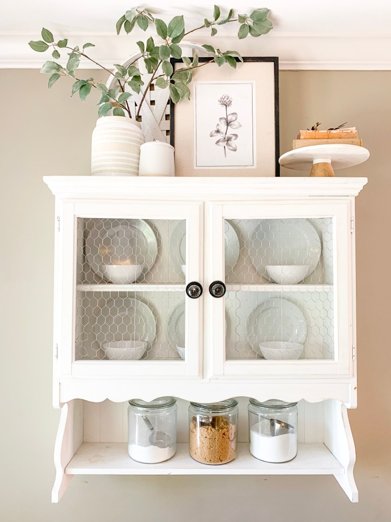 hanging hutch with floral print and vase decor
