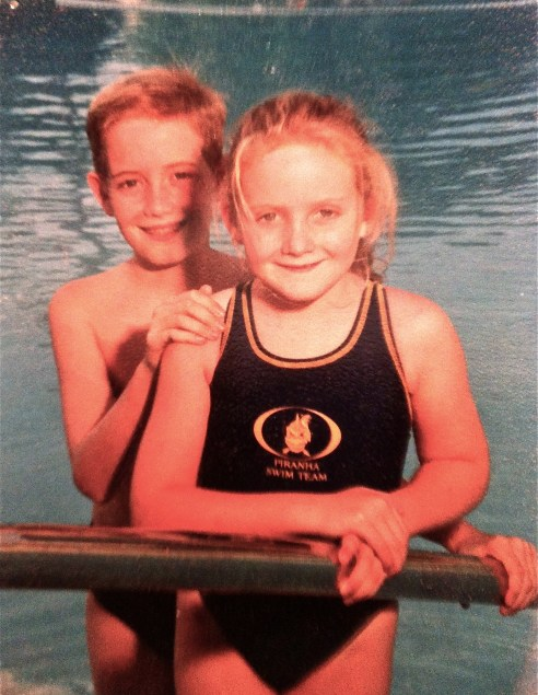 Robert and Kat a few years ago on photo day for the Piranha Swim Team.