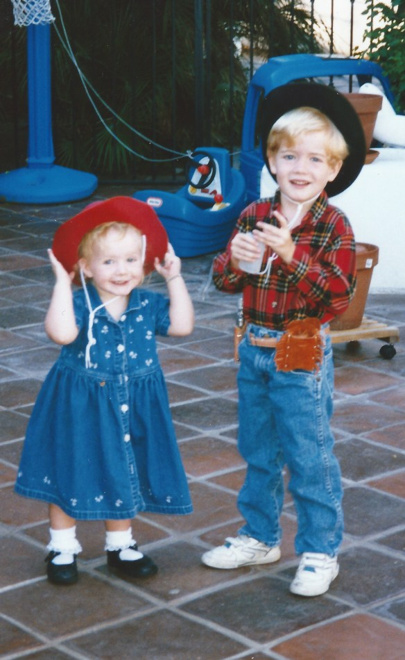 brother and sister playing cowboy