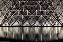 Louvre Pyramide by night gate crystal symmetric